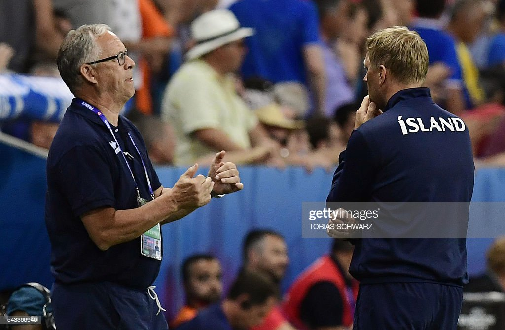 Iceland's coach Lars Lagerbaeck (L) and Iceland's coach Heimir Hallgrimsson react during Euro 2016 round of 16 football match between England and Iceland at the Allianz Riviera stadium in Nice on June 27, 2016. / AFP / TOBIAS
