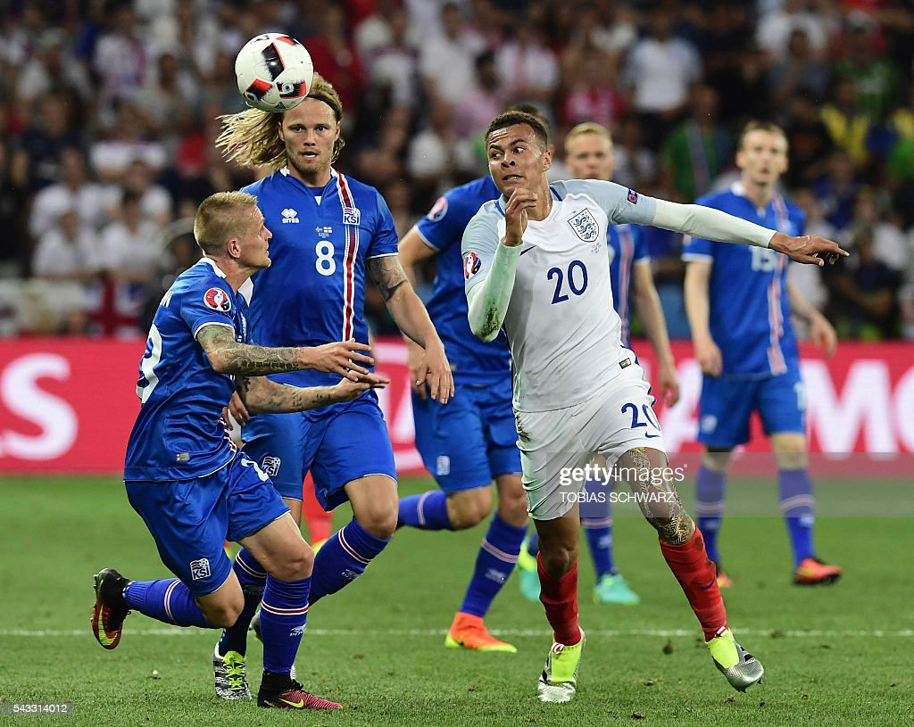 Iceland's defender Ari Skulason (L) and Iceland's midfielder Birkir Bjarnason vie for the ball against England's midfielder Dele Alli during Euro 2016 round of 16 football match between England and Iceland at the Allianz Riviera stadium in Nice on June 27, 2016. / AFP / TOBIAS