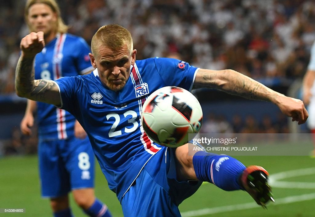 Iceland's defender Ari Skulason plays the ball during Euro 2016 round of 16 football match between England and Iceland at the Allianz Riviera stadium in Nice on June 27, 2016. / AFP / ANNE