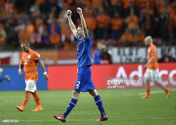 Iceland's defender Birkir Saevarsson after winning the the UEFA Euro 2016 qualifying round football match between Netherlands and Iceland at the...