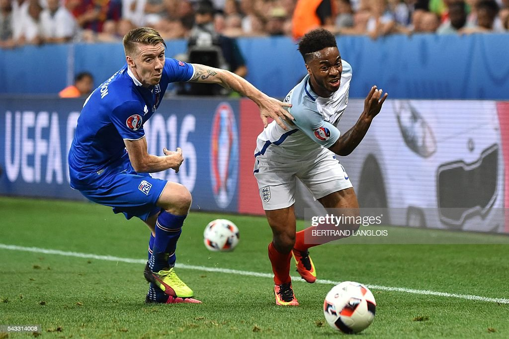 Iceland's defender Birkir Saevarsson (L) and England's defender Danny Rose vie for the ball during the Euro 2016 round of 16 football match between England and Iceland at the Allianz Riviera stadium in Nice on June 27, 2016. / AFP / BERTRAND