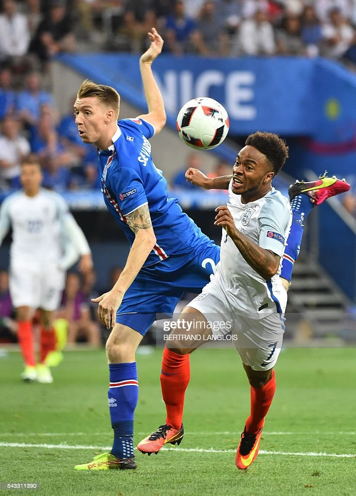 Iceland's defender Birkir Saevarsson and England's midfielder Raheem Sterling vie for the ball during the Euro 2016 round of 16 football match between England and Iceland at the Allianz Riviera stadium in Nice on June 27, 2016. / AFP / BERTRAND