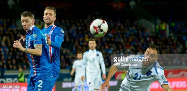 Iceland's defender Birkir Saevarsson and Kosovo's Atdhe Nuhiu vie for the ball during the FIFA World Cup 2018 qualification football match between...