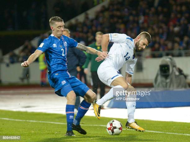 Iceland's defender Birkir Saevarsson and Kosovo's Valon Berisha vie for the ball during the FIFA World Cup 2018 qualification football match between...