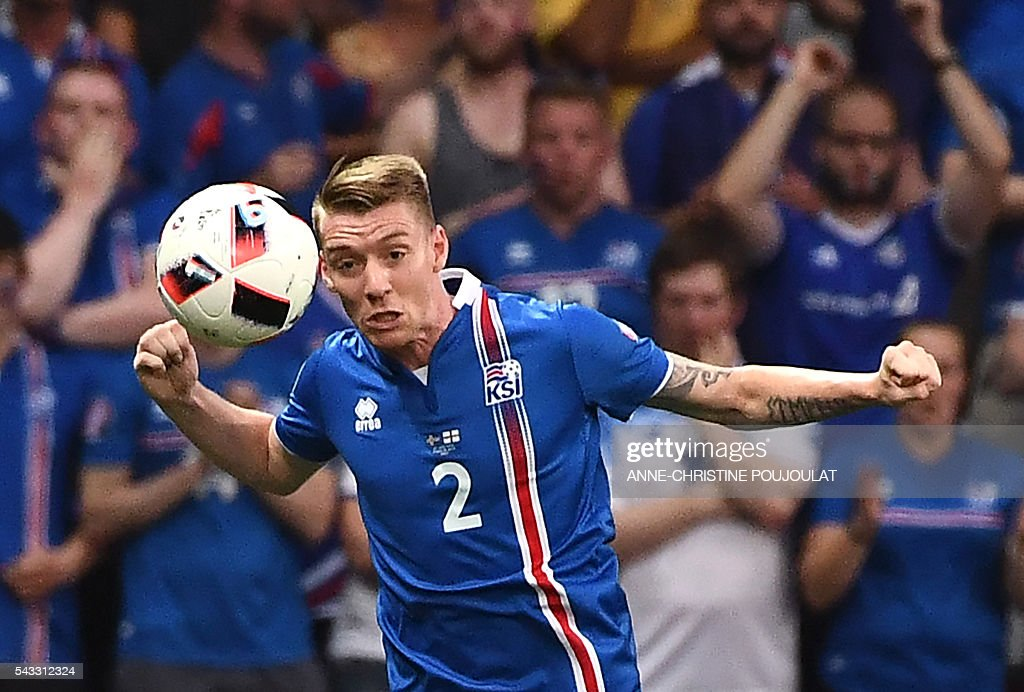 Iceland's defender Birkir Saevarsson plays the ball during Euro 2016 round of 16 football match between England and Iceland at the Allianz Riviera stadium in Nice on June 27, 2016. / AFP / ANNE