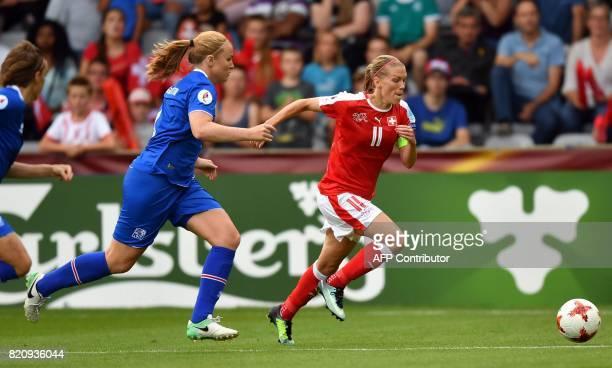 Iceland's defender Glodis Viggosdottir vies with Switzerland's midfielder Lara Dickenmann during the UEFA Womens Euro 2017 football tournament match...