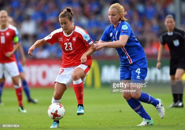Iceland's defender Glodis Viggosdottir vies with Switzerland's midfielder Vanessa Burki during the UEFA Womens Euro 2017 football tournament match...