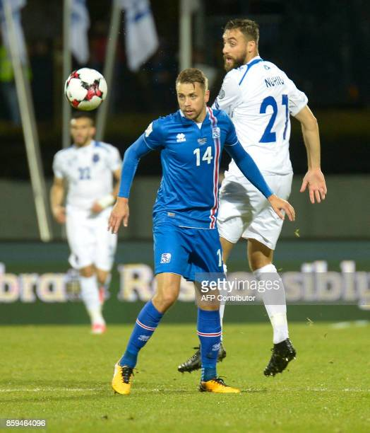 Iceland's defender Kari Arnason and Kosovo's Atdhe Nuhiu vie for the ball during the FIFA World Cup 2018 qualification football match between Iceland...