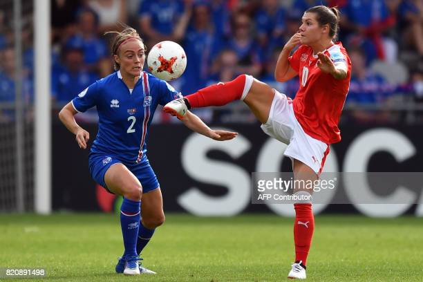 Iceland's defender Sif Atladottir vies with Switzerland 's forward Ramona Bachmann during the UEFA Womens Euro 2017 football tournament match between...