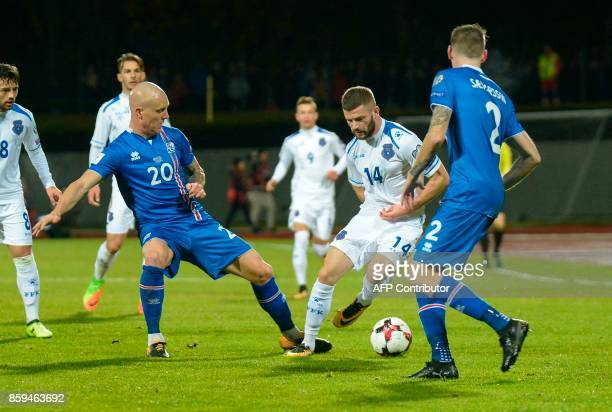 Iceland's Emil Hallfredsson and Kosovo's Valon Berisha vie for the ball during the FIFA World Cup 2018 qualification football match between Iceland...
