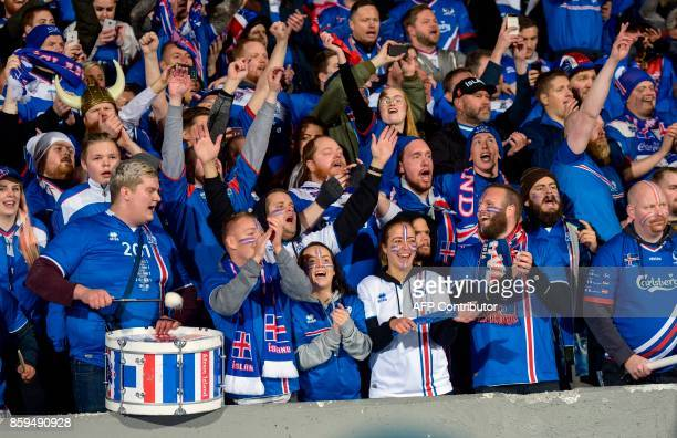 Iceland's fans celebrates during the FIFA World Cup 2018 qualification football match between Iceland and Kosovo in Reykjavik Iceland on October 9...