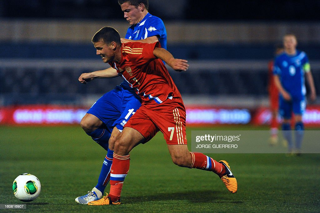 Iceland's forward Alfred Finnbogason (back) vies with Russia's midfielder Igor Denisov during the international friendly football match Iceland vs Russia at the municipal stadium in Marbella on February 6, 2013. AFP PHOTO / JORGE GUERRERO
