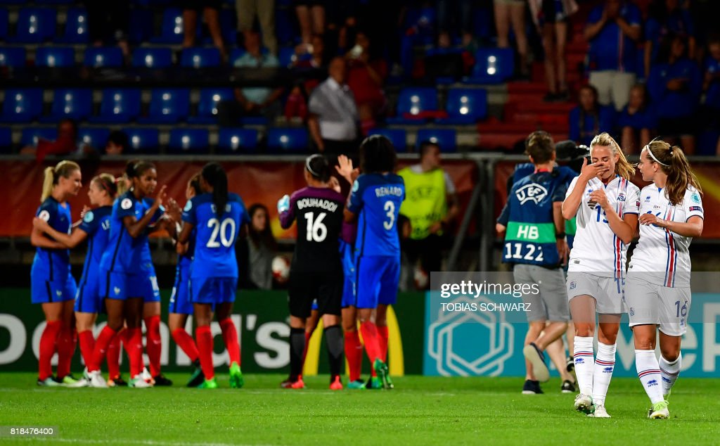 Iceland's forward Elin Metta Jensen (2nd R) and Iceland's forward Harpa Thorsteinsdottir react after the UEFA Women's Euro 2017 football tournament match between France and Iceland at Stadium Koning Wilhelm II in Tilburg on July 18, 2017. /