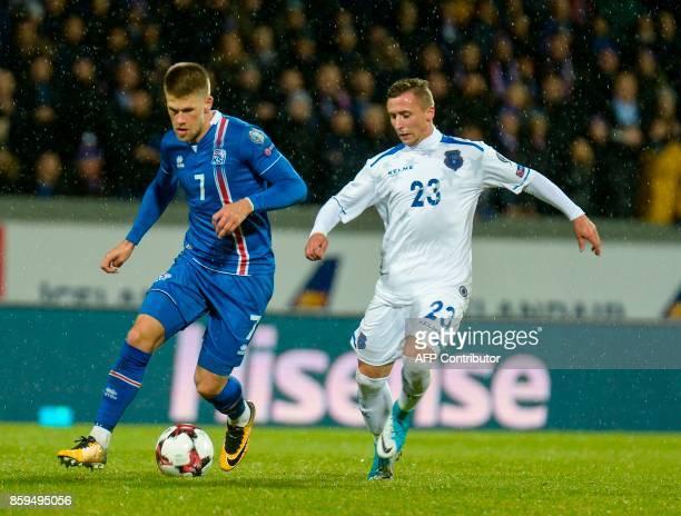 Iceland's forward Johann Berg Gudmundsson and Kosovo's Bernard Berisha vie for the ball during the FIFA World Cup 2018 qualification football match...
