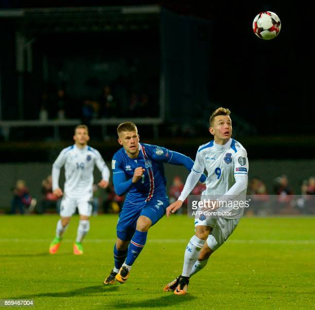 Iceland's forward Johann Berg Gudmundsson and Kosovo'S Bersant Celina vie for the ball during the FIFA World Cup 2018 qualification football match...