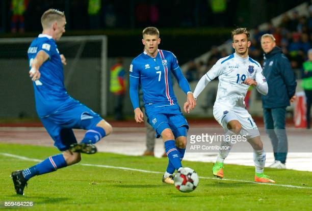 Iceland's forward Johann Berg Gudmundsson and Kosovo's Leart Paqarada vie for the ball during the FIFA World Cup 2018 qualification football match...