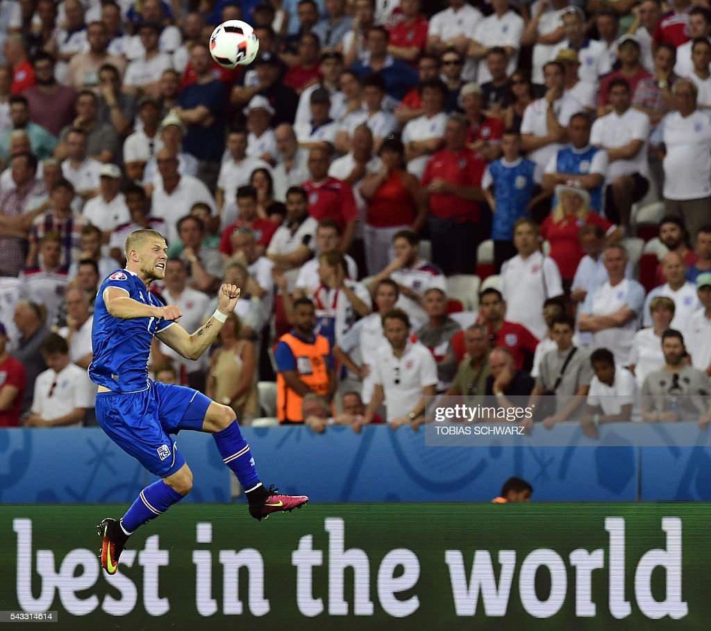 Iceland's forward Johann Berg Gudmundsson jumps for the ball during Euro 2016 round of 16 football match between England and Iceland at the Allianz Riviera stadium in Nice on June 27, 2016. / AFP / TOBIAS
