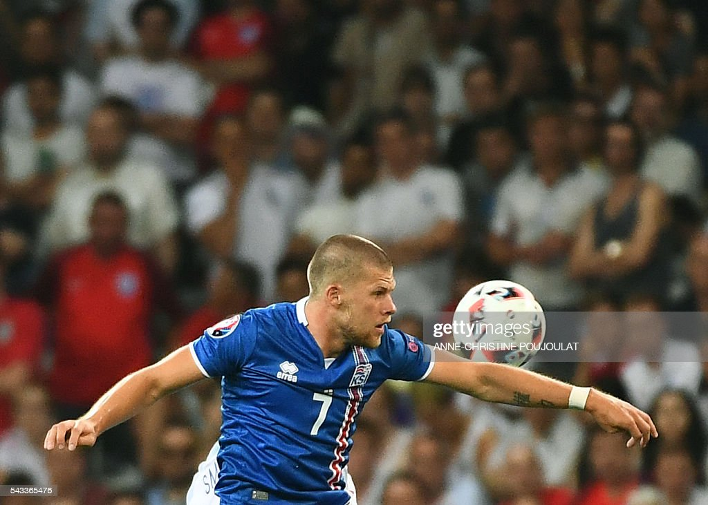 Iceland's forward Johann Berg Gudmundsson plays the ball during Euro 2016 round of 16 football match between England and Iceland at the Allianz Riviera stadium in Nice on June 27, 2016. / AFP / ANNE
