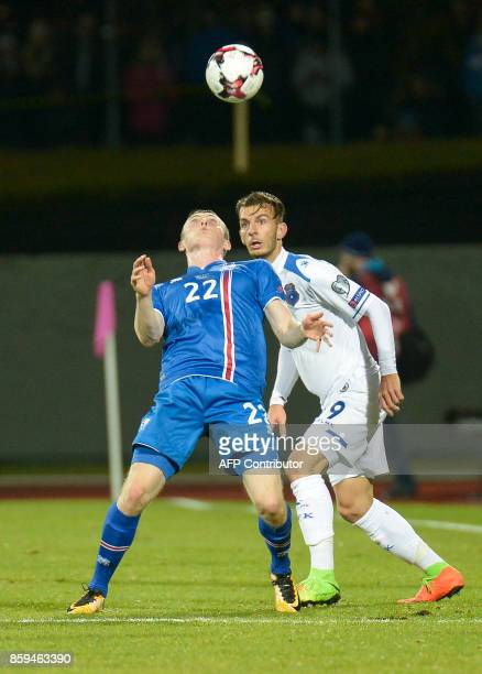 Iceland's forward Jon Dadi Bodvarsson and Kosovo's Bersant Celina vie for the ball during the FIFA World Cup 2018 qualification football match...