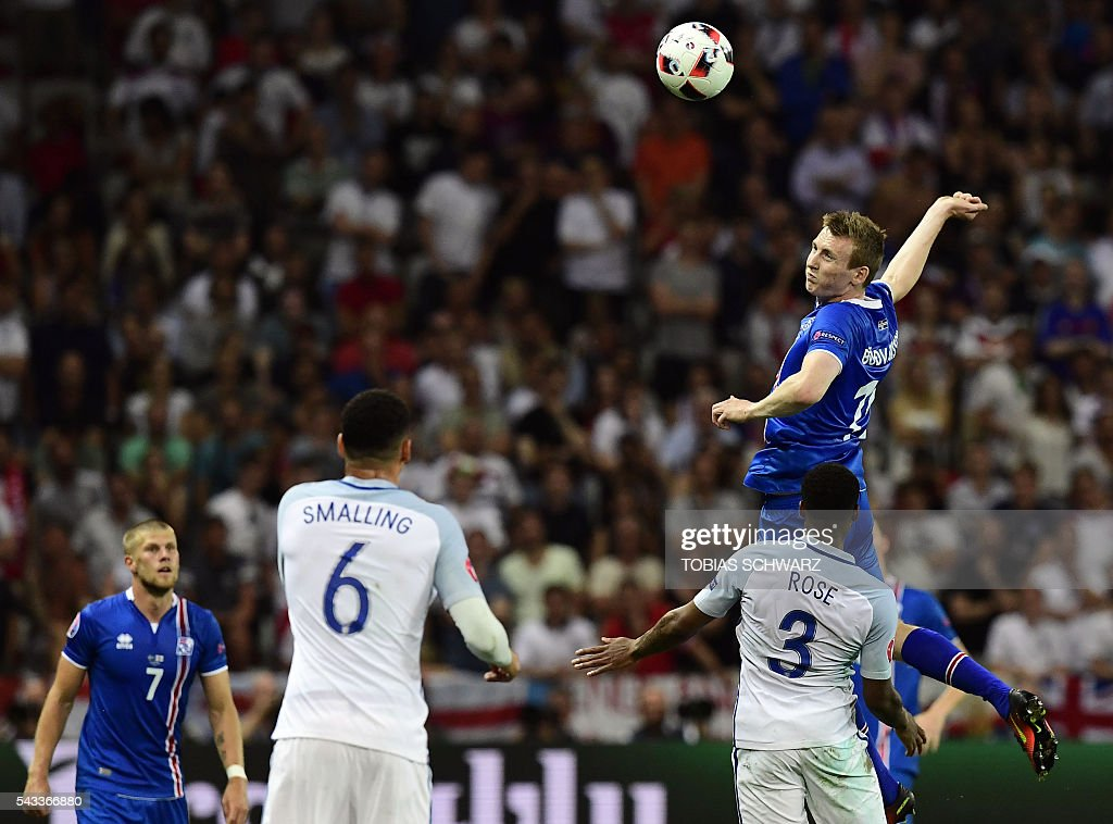 Iceland's forward Jon Dadi Bodvarsson jumps for the ball during Euro 2016 round of 16 football match between England and Iceland at the Allianz Riviera stadium in Nice on June 27, 2016. / AFP / TOBIAS