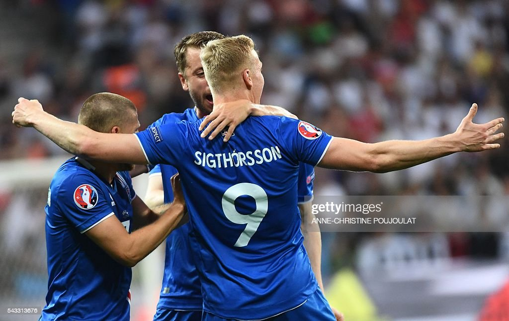 Iceland's forward Kolbeinn Sigthorsson (R) celebrates with teammates after scoring the 1-2 during Euro 2016 round of 16 football match between England and Iceland at the Allianz Riviera stadium in Nice on June 27, 2016. / AFP / ANNE