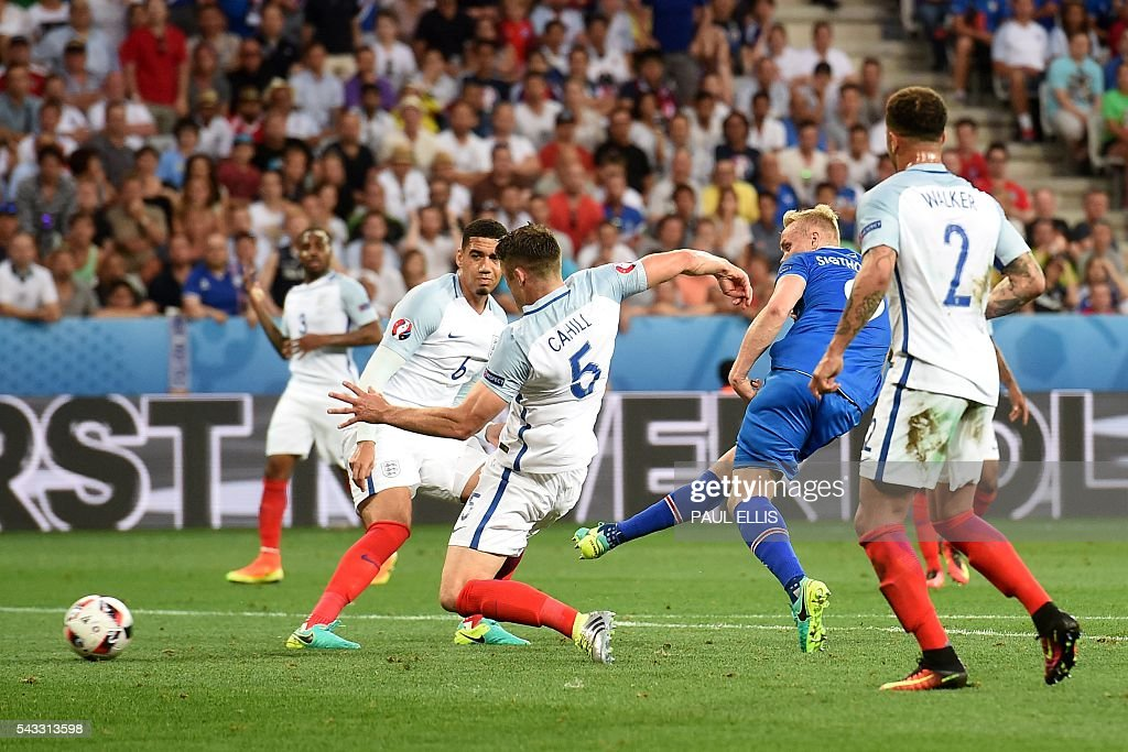Iceland's forward Kolbeinn Sigthorsson shoots to score Iceland's seconf goal during Euro 2016 round of 16 football match between England and Iceland at the Allianz Riviera stadium in Nice on June 27, 2016. / AFP / PAUL