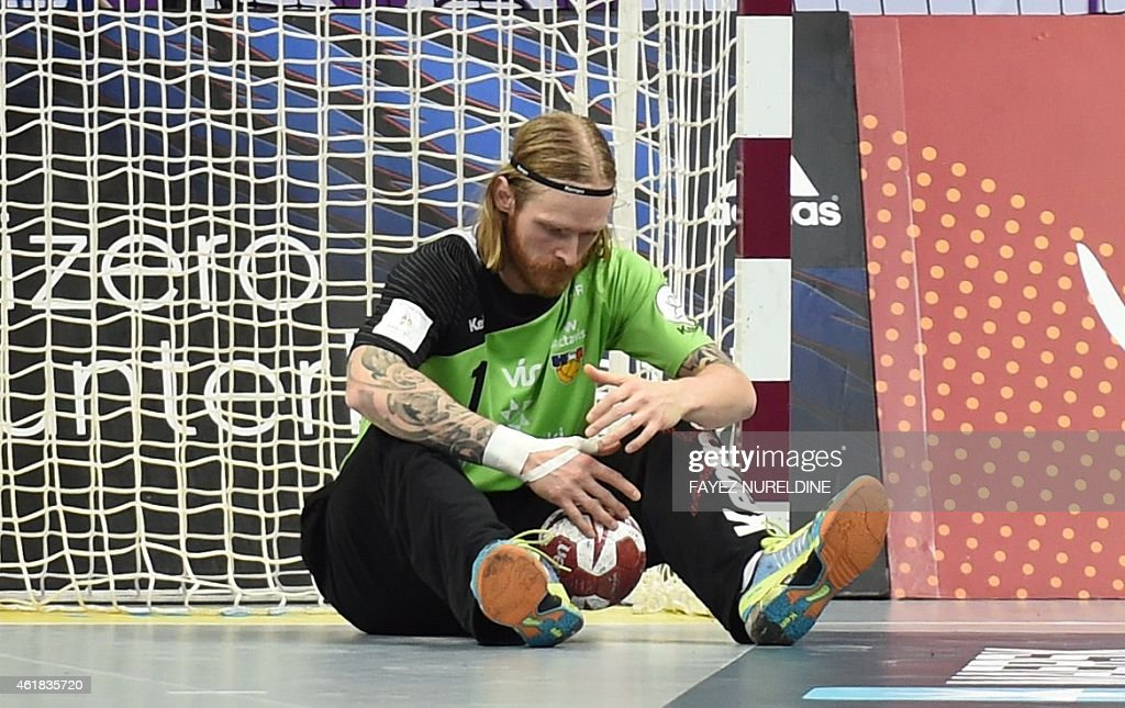 Iceland's goal keeper Bjorgvin Pall Gustavsson sits on the ground during the 24th Men's Handball World Championships preliminary round Group C match between Iceland and France at the Duhail Handball Sports Hall in Doha on January 20, 2015.