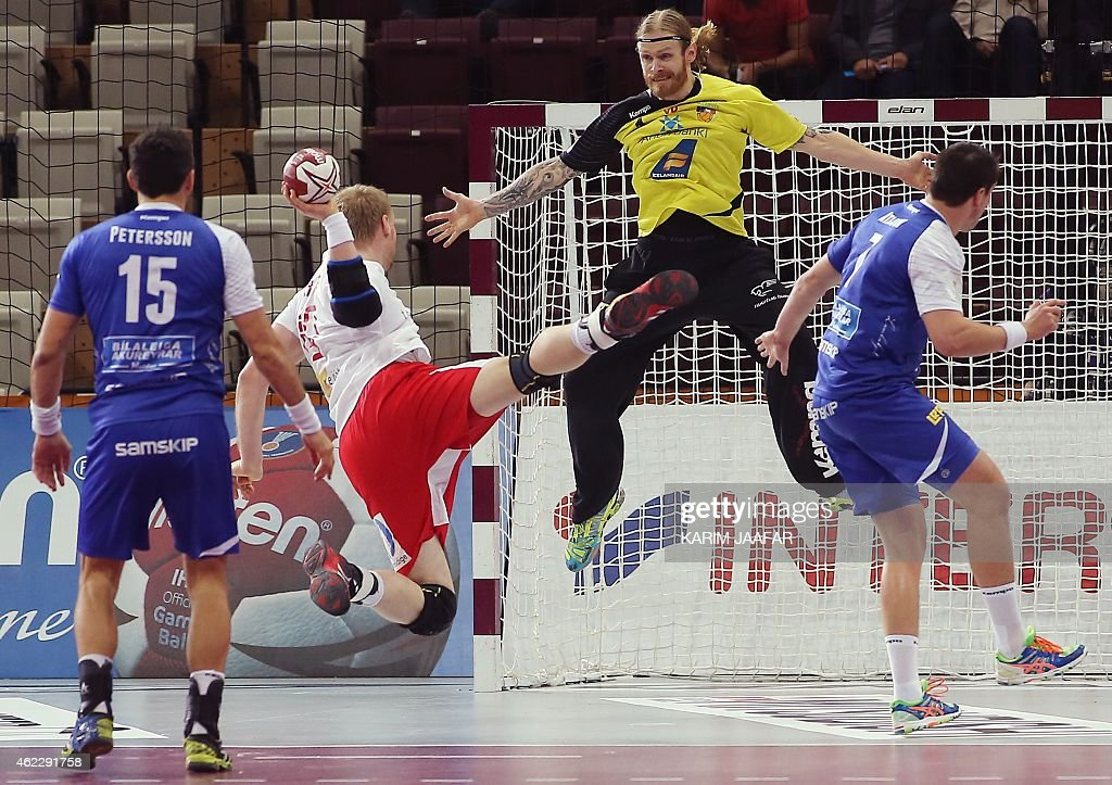 Iceland's goalkeeper Bjorgvin Pall Gustavsson (C) tries to save a shot during the 24th Men's Handball World Championships Eighth Final EF5 match between Iceland and Denmark at the Lusail Multipurpose Hall in Doha on January 26, 2015.