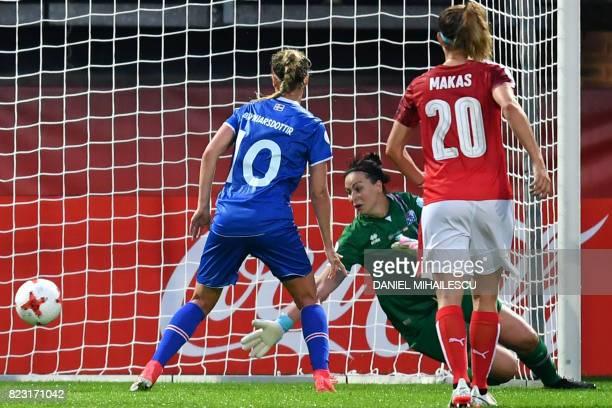 Iceland's goalkeeper Gudbjorg Gunnarsdottir fails to stop a goal during the UEFA Women's Euro 2017 football match between Iceland and Austria at the...