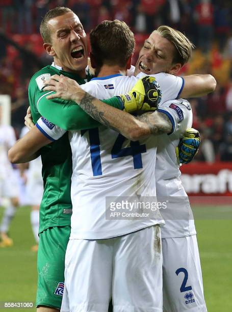 Iceland`s goalkeeper Hannes Halldorsson celebrates with teammates Kari Arnason and Birkir Seavarsson after their win following the FIFA World Cup...