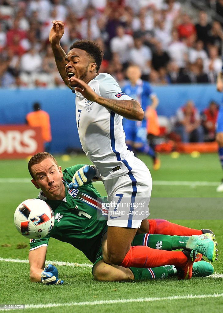 Iceland's goalkeeper Hannes Thor Halldorsson (L) and England's midfielder Raheem Sterling vie for the ball during the Euro 2016 round of 16 football match between England and Iceland at the Allianz Riviera stadium in Nice on June 27, 2016. / AFP / BERTRAND