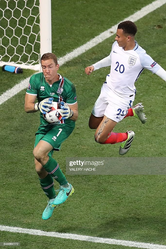 Iceland's goalkeeper Hannes Thor Halldorsson and England's midfielder Dele Alli vie for the ball during the Euro 2016 round of 16 football match between England and Iceland at the Allianz Riviera stadium in Nice on June 27, 2016. / AFP / Valery HACHE