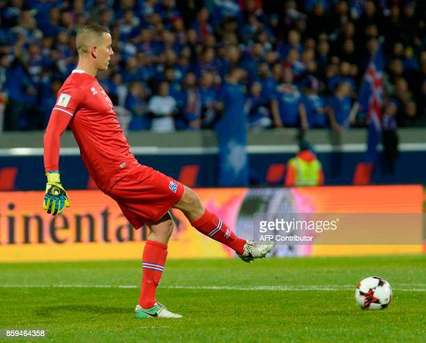 Iceland's goalkeeper Hannes Thor Halldorsson kicks out the ball during the FIFA World Cup 2018 qualification football match between Iceland and...