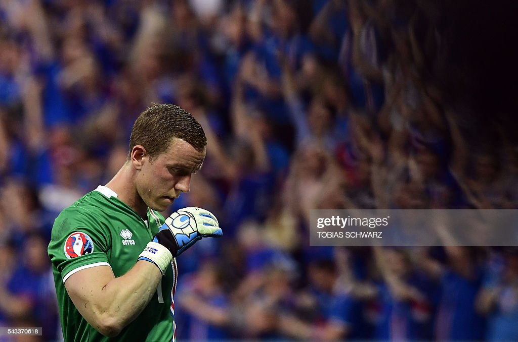 Iceland's goalkeeper Hannes Thor Halldorsson looks down after missing a penalty shot giving England their first goal during Euro 2016 round of 16 football match between England and Iceland at the Allianz Riviera stadium in Nice on June 27, 2016. / AFP / TOBIAS