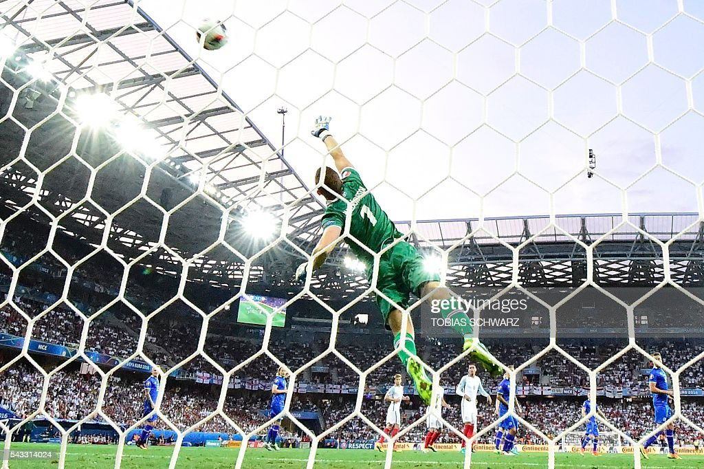 Iceland's goalkeeper Hannes Thor Halldorsson saves a ball during Euro 2016 round of 16 football match between England and Iceland at the Allianz Riviera stadium in Nice on June 27, 2016. / AFP / TOBIAS