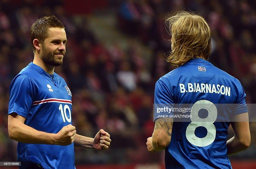 Iceland's Gylfi Sigurdsson and Birkir Bjarnason celebrate after Sigurdsson scored a penaly against Poland during the international friendly football...
