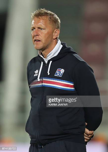 Iceland's head coach Heimir Hallgrimsson looks on from the sidelines during the friendly football match between Iceland and Qatar at the Abdullah bin...
