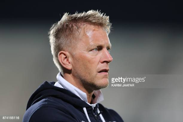 Iceland's head coach Heimir Hallgrimsson reacts on the sidelines during the friendly football match between Iceland and Qatar at the Abdullah bin...
