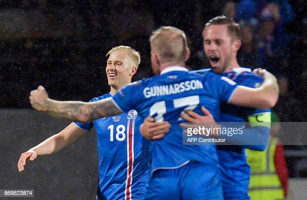 Iceland's Hordur Magnusson Iceland's midfielder Aron Gunnarsson and Iceland's midfielder Gylfi Sigurdsson celebrate after the FIFA World Cup 2018...