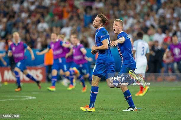 Iceland's Kari Arnason and team mate Ragnar Sigurdsson celebrate their victory at full time during the UEFA Euro 2016 Round of 16 match between...