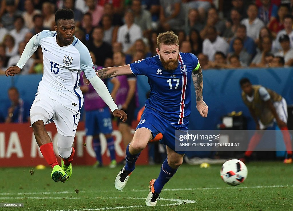 Iceland's midfielder Aron Gunnarsson (R) and England's forward Daniel Sturridge vie for the ball during Euro 2016 round of 16 football match between England and Iceland at the Allianz Riviera stadium in Nice on June 27, 2016. / AFP / ANNE