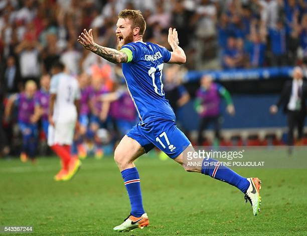 Iceland's midfielder Aron Gunnarsson celebrates at the end of the Euro 2016 round of 16 football match between England and Iceland at the Allianz...