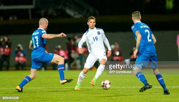 Iceland's midfielder Aron Gunnarsson Iceland's defender Birkir Saevarsson and Kosovo's Leart Paqarada vie for the ball during the FIFA World Cup 2018...