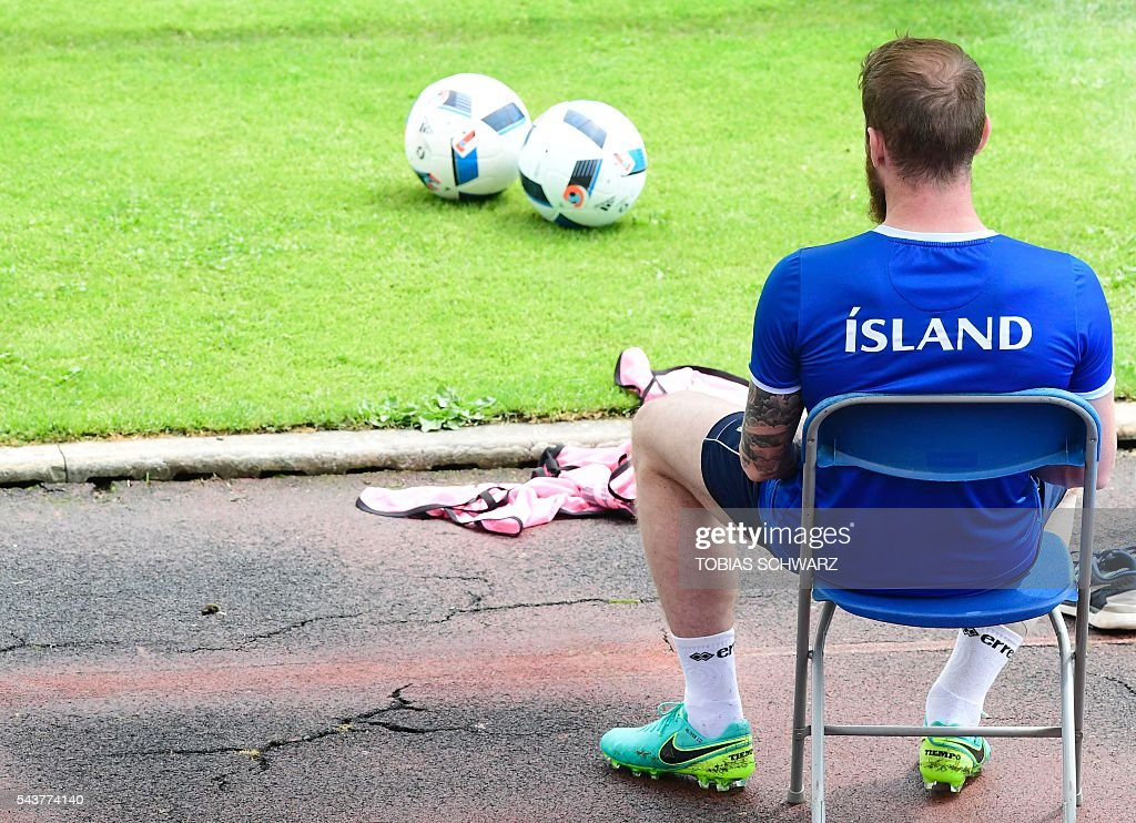 Iceland's midfielder Aron Gunnarsson looks on during a training session in Annecy on June 30, 2016, prior to their quarter-finals match against France on July 3. / AFP / TOBIAS