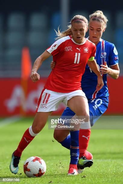 Iceland's midfielder Dagny Brynjarsdottir vies with Switzerland's midfielder Lara Dickenmann during the UEFA Womens Euro 2017 football tournament...