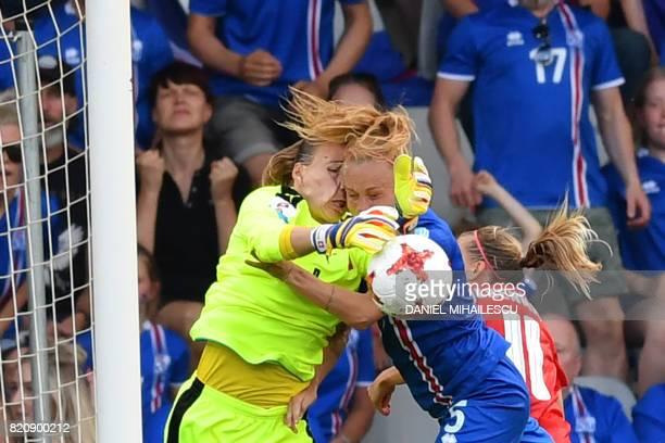 Iceland's midfielder Gunnhildur Jonsdottir vies with Switzerland's goalkeeper Gaelle Thalmann during the UEFA Womens Euro 2017 football tournament...