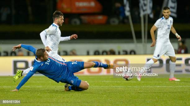 Iceland's midfielder Gylfi Sigurdsson and Kosovo's Besar Halimi vie for the ball during the FIFA World Cup 2018 qualification football match between...