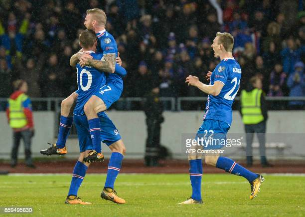 Iceland's midfielder Gylfi Sigurdsson Iceland's midfielder Aron Gunnarsson and Iceland's forward Jon Dadi Bodvarsson celebate at the FIFA World Cup...