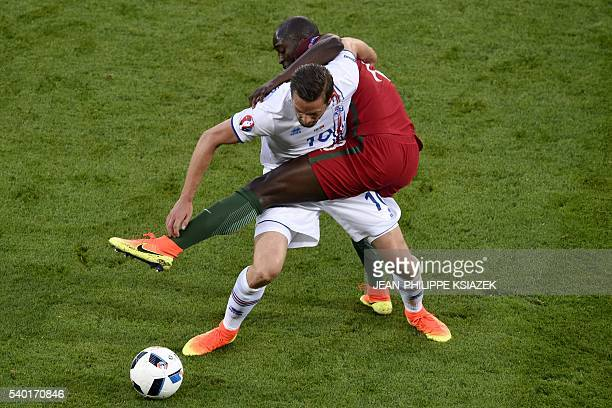 TOPSHOT Iceland's midfielder Gylfi Sigurdsson vies for the ball against Portugal's midfielder Danilo Pereira during the Euro 2016 group F football...