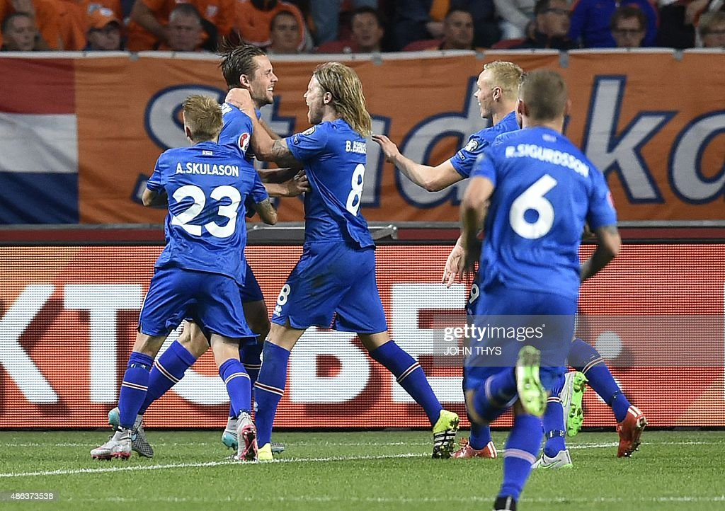 Iceland's midfielder Gylfi Thor Sigurdsson celebrates after scoring a penalty kick during the UEFA Euro 2016 qualifying round football match between...